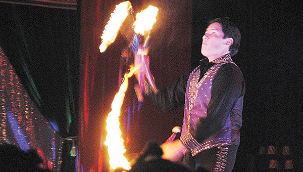 Photo by Aaron Paden / Alejandro Garcia juggles flaming torches to the awe of more than 190 children and their family Saturday night at the Star Family Circus held at the National Guard armory on Highway 84. The event has 16 acts, including trapeze artists, clowns and archery.
