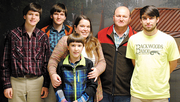 Photo by Aaron Paden / Nathan Lambert, right, poses for a photo with his parents, Amanda and James Lambert, and his three brothers, Nicholas, Noah and Nolan, at Backwoods Bayou where Nathan works after school.