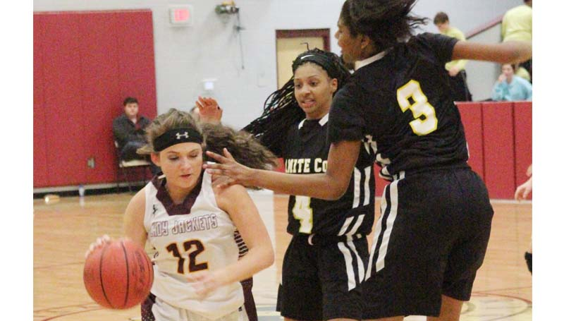 Daily Leader / Patty Emfinger / Enterprise's Courtney Greer (12) drives past two Bassfield defenders in girls' action Tuesday night.