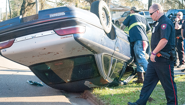Photo by Kaitlin Mullins / A car accident Wednesday afternoon on Union Street sent one woman to the hospital after first responders extracted her from the flipped-over Crown Victoria.