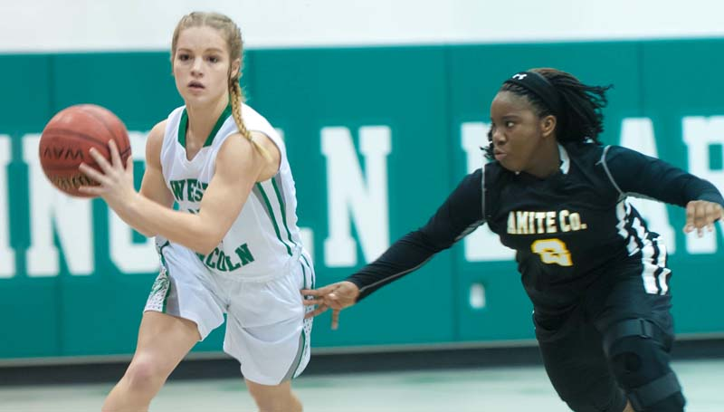 Daily Leader / Teresa Allred / West Lincoln's Carly Holden (left) prepares to pass the ball down the court against Amite County Friday night at Jack Case Gymnasium.