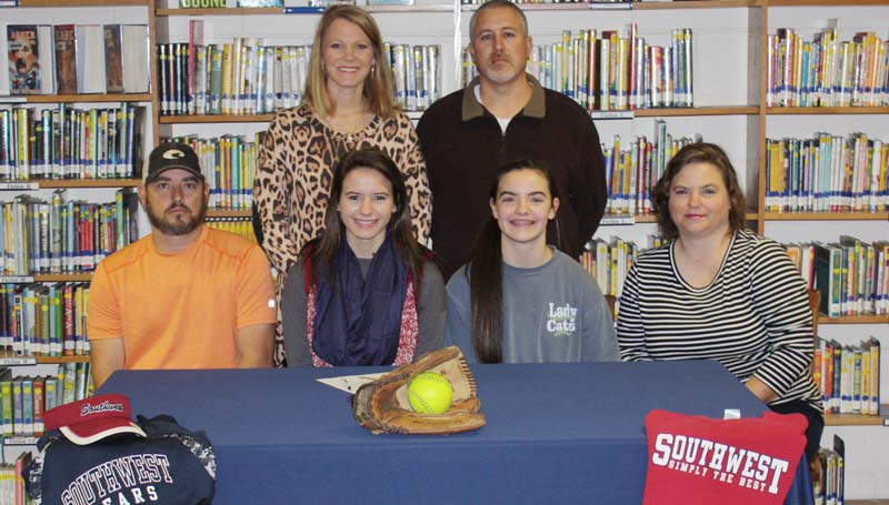 Daily Leader / Photo submitted / Bogue Chitto's pitcher/third baseman Alana Nettles has signed a softball scholarship to play for the Southwest Community College Lady Bears next year. Pictured with Alana is (from left) Jamie Nettles (father), Alece Nettles (sister), and Dana Nettles (mother). Standing in the back is Bogue Chitto assistant coach Denise Leggett (left) and Bogue Chitto softball coach Scott Leggett.