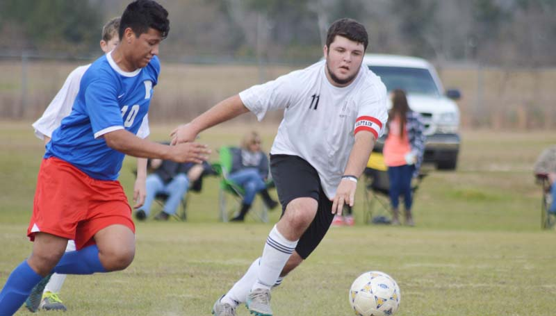 Daily Leader / Chris King / Loyd Star senior captain and midfielder Lane Rogers battles for the ball in boys soccer action Saturday against Forest. The Hornets lost to Forest 4-1.