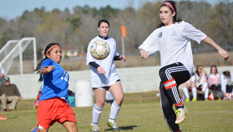 Daily Leader / Chris King / Loyd Star senior captain and defender Shelby Richardson prepares to steal the ball away from a Forest player in girls soccer action Saturday. The Lady Hornets and the Lady Bearcats finished with a 1-1 tie.