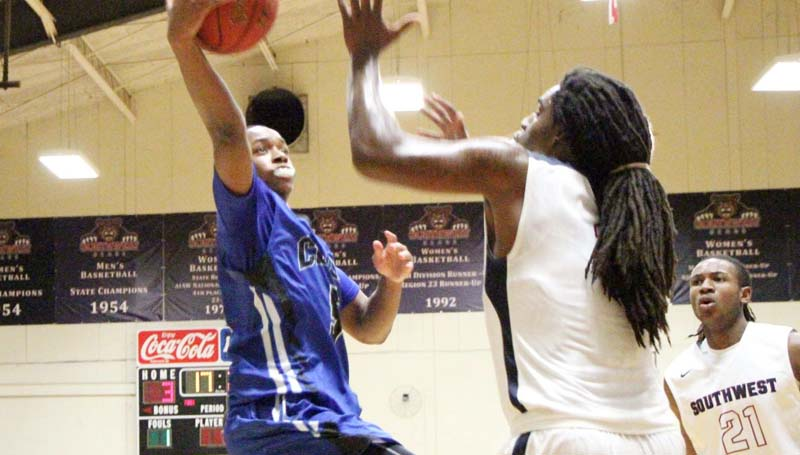 Co-Lin Media / Natalie Davis / Co-Lin's point guard Jonathan Dalton (3) hits the layup over Southwest's LaDerrius Simmons (4) Tuesday night.