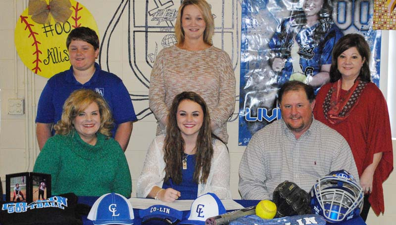 Daily Leader / Photo submitted / Brookhaven Academy's Allison Livingston has signed softball scholarship with the Copiah-Lincoln Community College Lady Wolves. Pictured with Allison is her mother Tammy Livingston (left) and father David Livingston. Standing is Jake Livingston (brother), Brookhaven Academy head softball coach Becky Flowers and Laura Livingston.