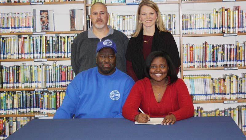 Daily Leader / Photo submitted / Bogue Chitto's pitcher Christian Black has signed softball scholarship with the Copiah-Lincoln Community College Lady Wolves. Pictured with Christian is her father Charlie Black (left). Standing is Bogue Chitto head softball coach Scott Leggett (left) and Bogue Chitto assistant coach Denise Leggett.