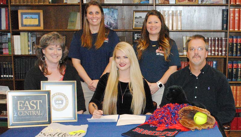 Daily Leader / Marty Albright / Brookhaven Lady Panthers pitcher Katherine Shell has signed a softball scholarship with the East Central Community College Lady Warriors. Present for the ceremony were her parents (seated) Lucy and Matt Shell; and (standing) Brookhaven softball coach Mandy Vinson and assistant coach Megan Bateman Case.