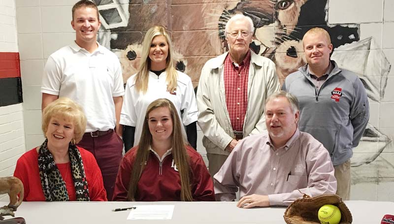 Daily Leader / Photo Submitted / Lawrence County's Jordan Harp has signed a softball scholarship with the Southwest Community College Lady Bears. Present for the ceremony were her parents (seated) Hershel and Jana Harp. Standing is Lawrence County Assistant Coach Marc Howard, Lawrence County Head Coach Meleah Howard, her Grandfather, Robin B. Penn, and Lawrence County Athletic Director Corey Keyes.