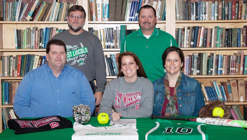 Daily Leader / Teresa Allred / West Lincoln's shortstop Layton Sill has signed a softball scholarship to play for the East Mississippi Community College Lady Lions next year. Pictured with Layton is (from left) father Ben Sills, and mother Lindy Sills. Standing in the back is West Lincoln assistant coach Greg Allen (left) and West Lincoln softball coach Andrew Redd.