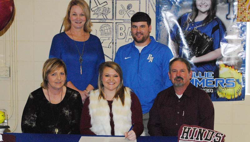 Daily Leader / Marty Albright / Brookhaven Academy's pitcher Alli Summers has signed a softball scholarship to play for the Hinds Community College Lady Bulldogs next year. Pictured with Alli is her parents (from left) Dana and Steve Summers. Standing in the back is Brookhaven Academy coach Becky Flowers (left) and Brookhaven Academy Athletic Director Blake Purvis.