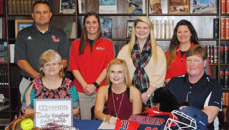 Daily Leader / Marty Albright / Brookhaven's catcher/infielder Haley Speaks has signed softball scholarship with the Hinds Community College Lady Bulldogs. Pictured with Haley is her mother Tiffany (left) and her father Jim Speaks. Standing is Brookhaven Athletic Director Tommy Clopton, Brookhaven softball coach Mandy Vinson, Alycen Speaks (sister) and Brookhaven assistant coach Megan Bateman Case.