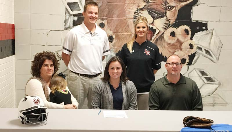 Daily Leader / Jana Harp / Lawrence County's pitcher Elizabeth Smith has signed a softball scholarship with the Copiah-Lincoln Community College Lady Wolves. Present for the ceremony were her parents (seated) Michael and Yvette Smith and sister Eden. Standing is Lawrence County assistant coach Marc Howard and Lawrence County head coach Meleah Howard.