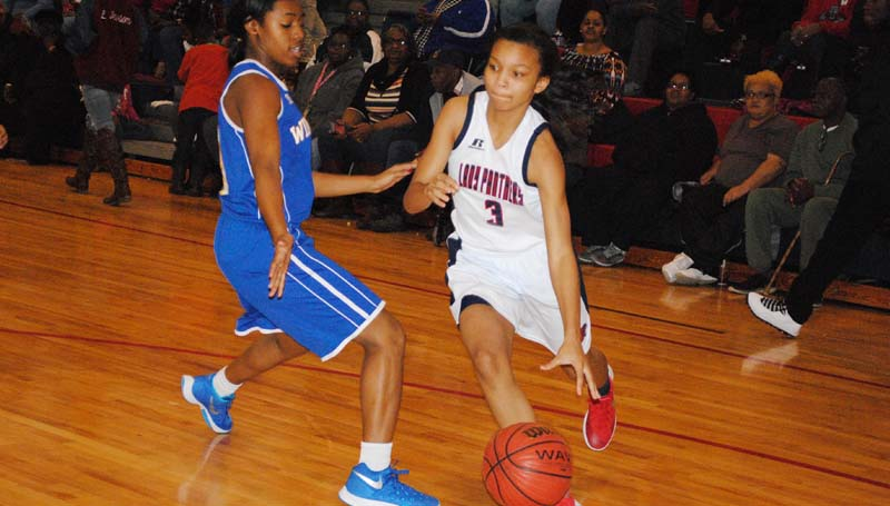Daily Leader / Marty Albright / Brookhaven's Taylor Carter (3) drives past a Wingfield defender in girls' action Friday night.