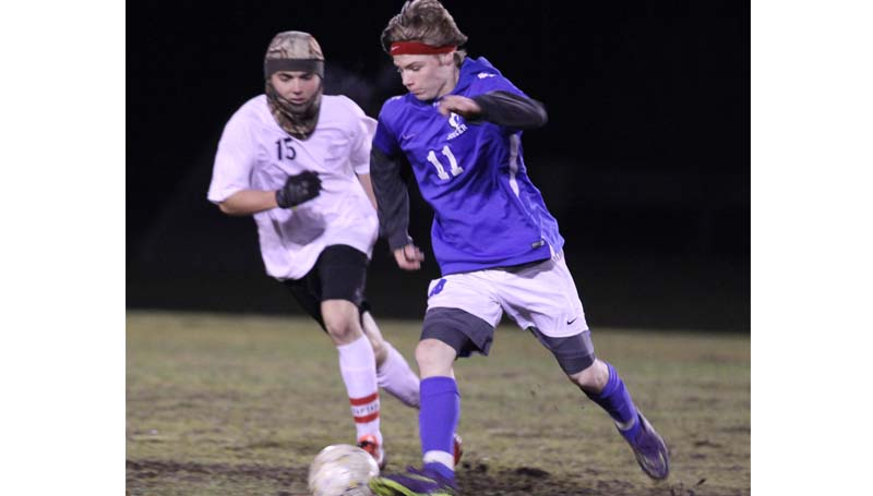Daily Leader / Amy Rhoads / Loyd Star senior Ryan Nevels and Wesson's Steve Dennis battle for the ball in boy's soccer action Friday night at Hansel King Sportsplex.