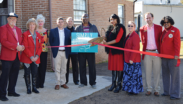 Photo by Regan Barksdale / Shown above is the owner of Simply Beautiful Gift Shop, Linda Williams (holding scissors), her husband, Chester Lee Williams Jr. (holding sign), along with members of the Brookhaven-Lincoln County Chamber of Commerce. Simply Beautiful Gift Shop is located at the back of Shannon's Hair Creation on Brookhaven Street.