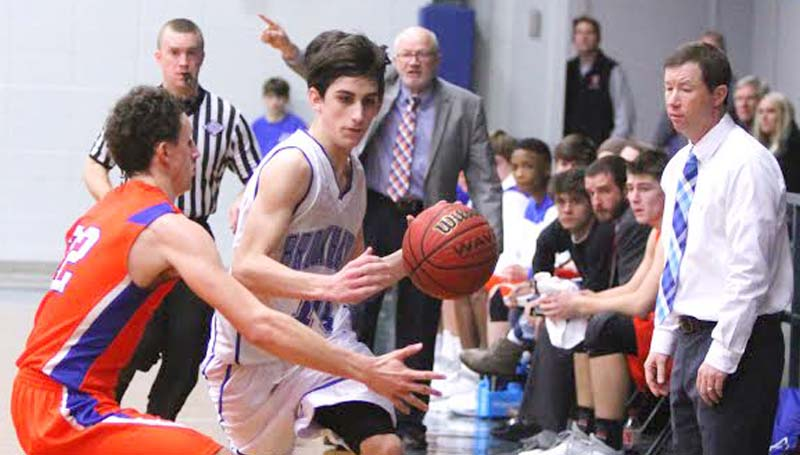 Daily Leader / Sherylyn Evans / Brookhaven Academy's Luke Jackson (10) protects the ball against Columbia Academy's Wiley Cleveland (22) Saturday as Coach Dale Watts and Coach Josh Watts watch closely.