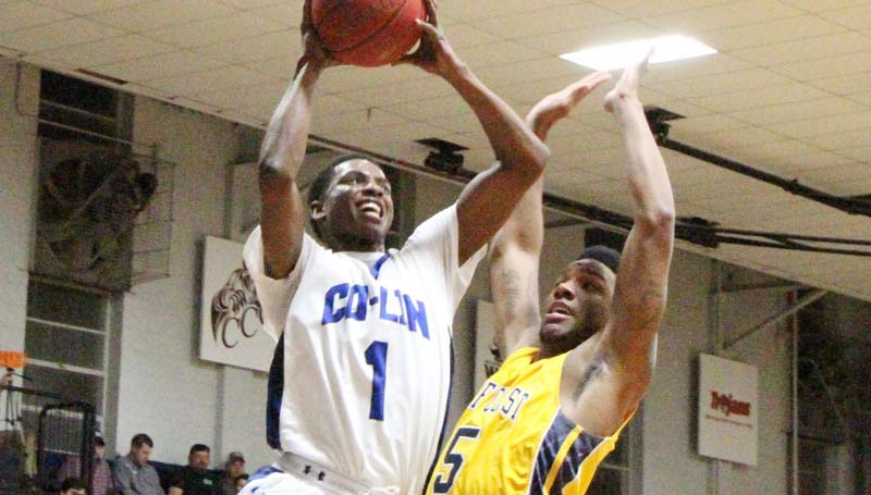 Daily Leader / Natalie Davis / Co-Lin's Dearius Griffin (1) scores against Gulf Coast's Zach Parker (5) in men's JUCO action Monday night at Mullen Gymnasium.