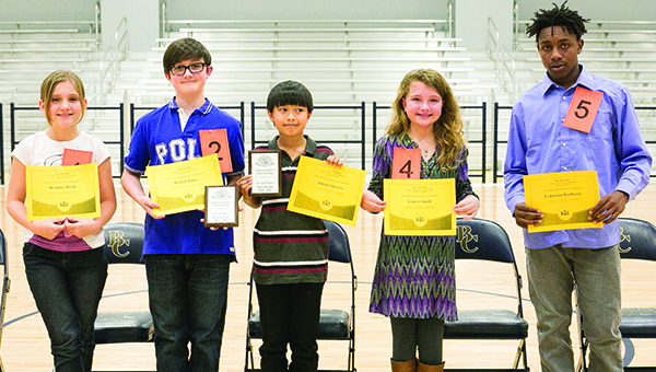 """Photo by Kaitlin Mullins / Contestants in the Lincoln County Spelling Bee, left, on Monday were (from left) Breanna Meche of Bogue Chitto, Bennet Jones of Lipsey, Ashton Ogletree of Brookhaven Elementary, Gentry Smith of West Lincoln and Cedarious Brotherns of Alexander Junior High. Jones placed first with the winning word """"tranquil"""" in the fifth round. Jones will go on to participate in the state competition March 15 at 10 a.m. at the MS Public Broadcasting Building. Ogletree placed second."""