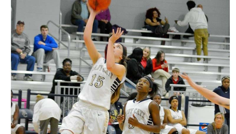 Daily Leader / Stacy Leake / Bogue Chitto's Karlie Williams (15) drives in for a layup Tuesday night against West Marion.