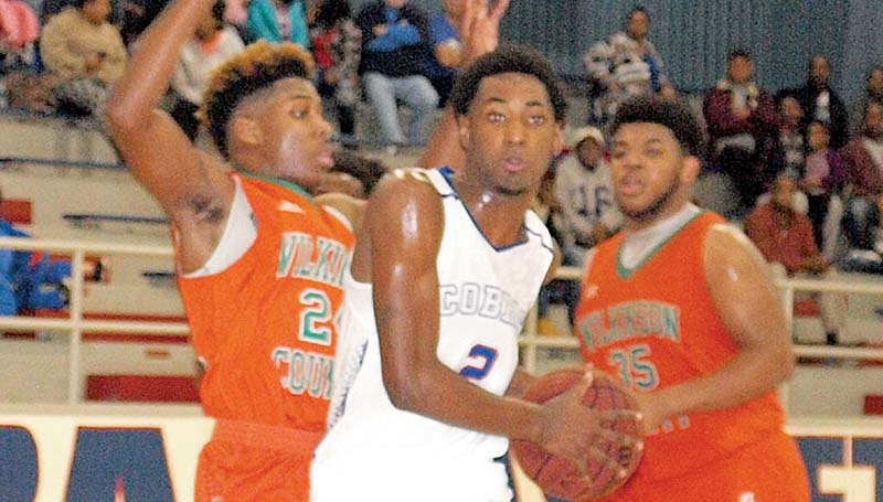 Daily Leader / Tracy Fischer / Wesson's Eric Rhymes (2) drives to the basket against Wilkinson County Travion Jones (24) and LaThomas Sharp (35) Tuesday night at the Snake Pit.