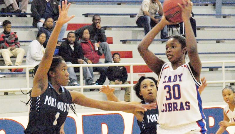 Daily Leader / Erich Fischer / Wesson Jashia Smith (30) looks for an open teammate while being double-teamed by Port Gibson JaQuita Mccay (1) and Glendolin Watson (20) Wednesday night.