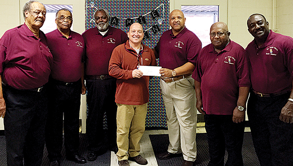 Photo by Alex Jacks / Members of Mt. Wade Baptisth Church Men's Senior Mission donated more than $1,000 to Mamie Martin. Pictured are Dewitt Washington, Andrew Spiller, Charles Williams, Mamie Martin Principal Rob McCreary, Rev. Randolph Hamilton, George Brown Jr. and James Dillon.