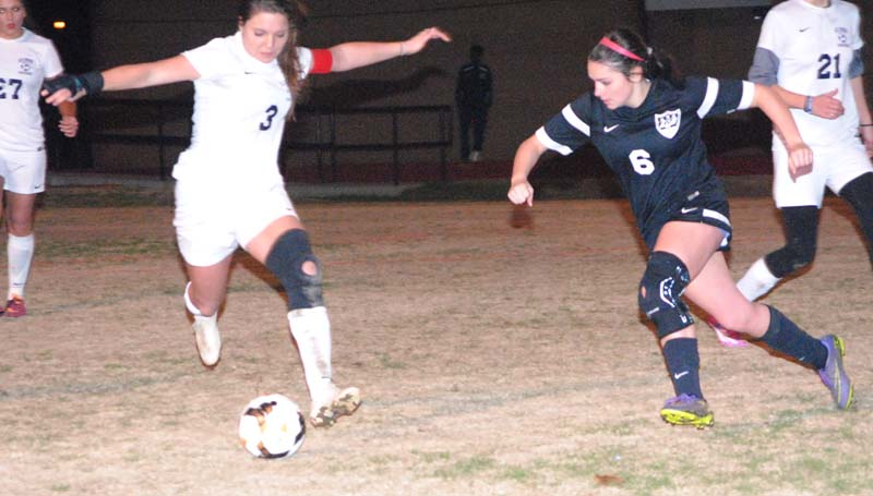 Daily Leader / Marty Albright / Brookhaven's Fallon Brooks (3) prepares to kick the ball down the field against Long Beach Thursday night at King Field.
