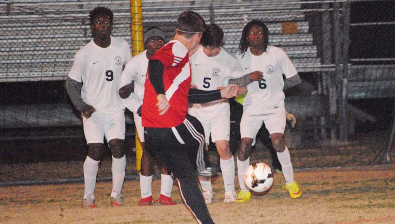 Daily Leader / Marty Albright / Brookhaven's Malik Anton, Adrian Lockwood, Tre Laird and Noah Spears form a wall to defend the goal against Pascagoula Thursday night in boys action at King Field.