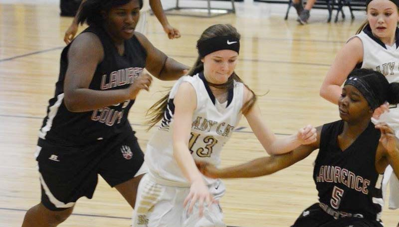Daily Leader / Stacy Leake / Bogue Chitto's Karlie Williams (13) fights to keep possession of the ball against two Lawrence County defenders Saturday afternoon.