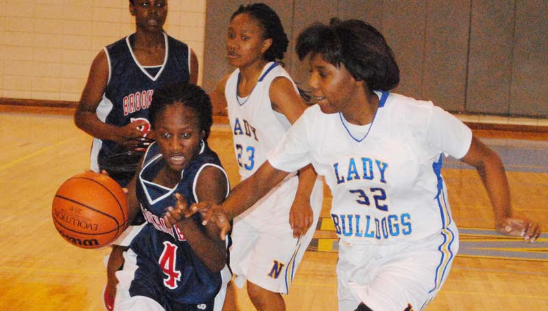 Daily Leader / Marty Albright / Brookhaven's Miyah Miller (4) drives to the basket against Natchez in girls' action.