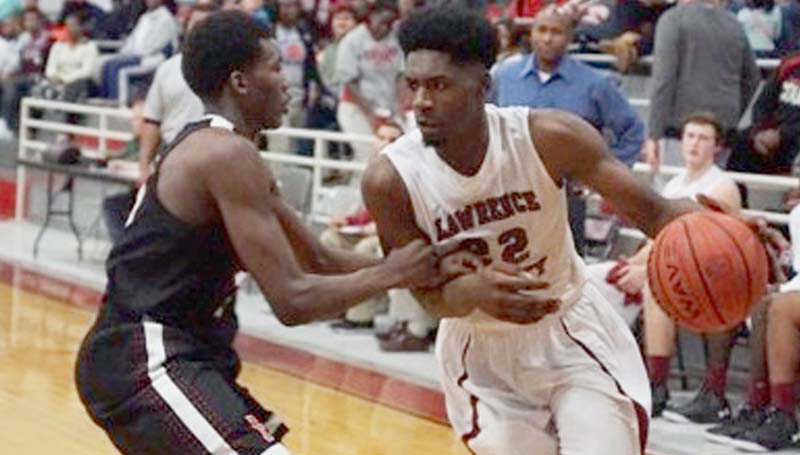 Daily Leader / Jana Harp / Lawrence County's Keyshawn Feazell (22) prepares to drive past an Florence defender in Friday's boys action in Monticello.