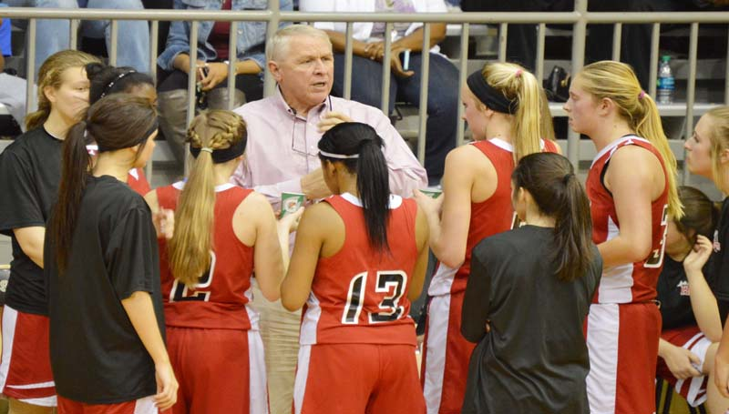 "Daily Leader / Chris King / Loyd Star's coach Gene ""Moochie"" Britt provides instructions to his Lady Hornets during a timeout in girls' action at Bassfield."