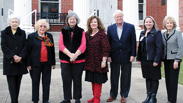 Photo by Aaron Paden / (From left) Mrs. Jim C. Barnett, Dott Cannon, Shirley Estes, Jennifer Jackson, Bill Sones, Suzanne Hirsch and Katherine Bumgarner meet in front of Lampton Auditorum Thursday. Those who attended Thursday's event are all sponsors who have purchased a brick to help fund the renovation of Elizabeth Cottage.