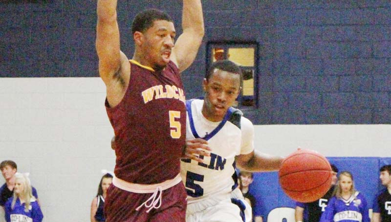 Co-Lin Media / Natalie Davis / Co-Lin's point guard Jonathan Dalton (5) is fouled by Pearl River's Dontelis Ross (5) in men's JUCO basketball action Monday night.