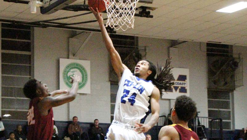 Co-Lin Media / Natalie Davis / Co-Lin's Donte' Watson (24) drives in for the layup against Jones County Thursday night.