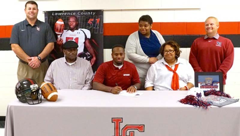 Daily Leader / Jana Harp / Brandon Armstrong signs with Southwest Mississippi College Community College to play football. Pictured with Armstrong are his parents (seated) Amel and Linda Armstrong. Standing is Lawrence County football coach Jaymie Palmer, sister Breanna Armstrong and Lawrence County Athletic Director Corey Keyes.