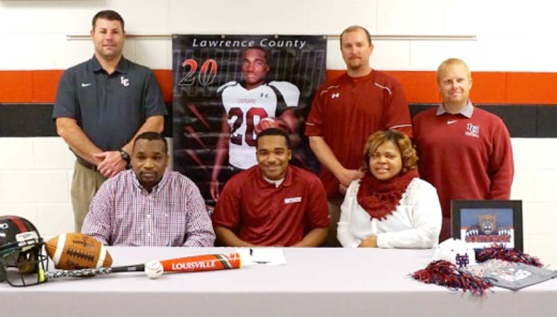 Daily Leader / Jana Harp / Lawrence County's T-Tez Cole signs with Southwest Mississippi Community College to play baseball and football. Pictured with Cole is his parents Lenorris and Wakeshia Cole. Standing is Lawrence County football coach Jaymie Palmer, Lawrence County baseball coach Josh Garrett and Lawrence County Athletic Director Corey Keyes.