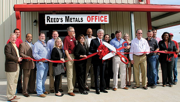 Photo submitted / The grand opening and ribbon cutting ceremony took place at the new Reed's Metals location in Meridian recently. Gov. Phil Bryant served as guest speaker and showed his support of small business in Mississippi. Bryant, along with many local and statewide officials, were in attendance. The company is a metal manufacturer that specializes in metal roofing, metal buildings and pole barns. Reed's Metals of Meridian can be contacted at 601-482-1500 or visit www.reedsmetals.com.