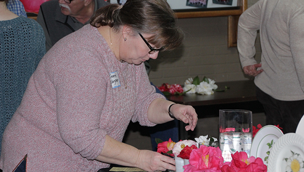 Photo by Alex Jacks / Renée Yaeger judges bloom entries during the 53rd annual Camellia Show held at the Brookhaven Recreation Department Saturday. Entries came from all over the country including Florida and Louisiana.