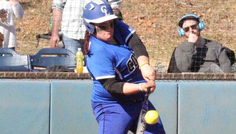 Co-Lin Media / Lucas Calvert / Co-Lin catcher Jessica Crum hits a home run to straight away centerfield in Sunday's softball action against Itawamba.