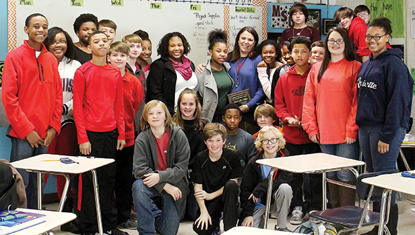 Submitted photo / Laura Ann Walker, seventh-grade math teacher, poses with her class after being chosen as Brookhaven School District's Teacher of the Year.