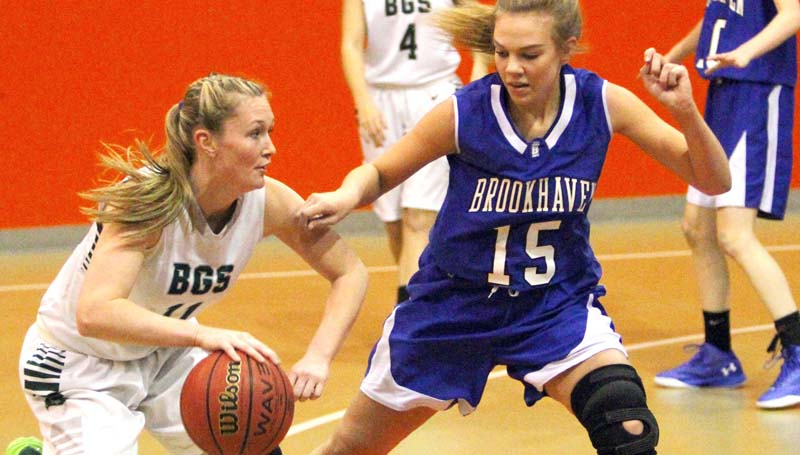 Daily Leader / Sherylyn Evans / Brookhaven Academy's Sissy Byrd (15) applies defensive pressure on Bowling Green's Ashley Foret (11) Tuesday in girls MAIS AAA South State tournament action at Columbia Academy.