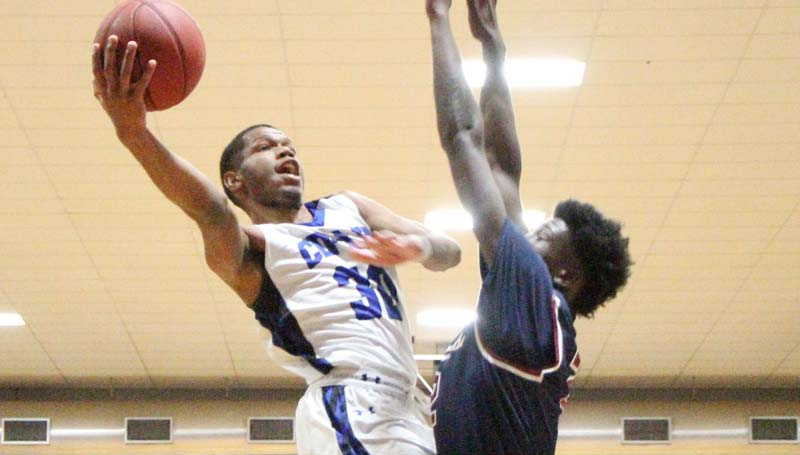 Co-Lin Media / Natalie Davis / Southwest's James Hawthorne tries to block the shot by Co-Lin's Darius Kennedy (30).