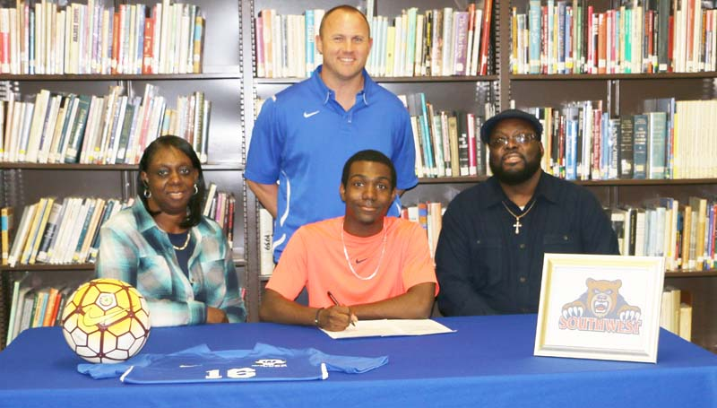 Daily Leader / Photo submitted / Wesson Attendance Center senior soccer standout Marcus Jones signs a soccer scholarship Friday with Southwest Community College Bears. Jones was recently named Most Valuable Mid-Fielder for the Region 6 Boys Soccer Division. Present for the signing are Jones parents, Audrey E. Jones and Willie Earl Arnold; (standing) Wesson soccer coach John Douglas.