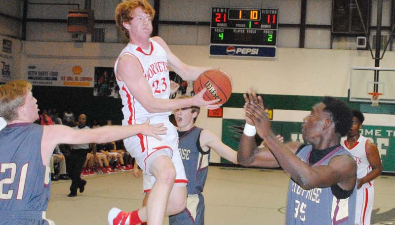 Daily Leader / Marty Albright / Loyd Star's Levi Redd (23) glides in to score a layup over Enterprise's Jontavious Smith (35) Tuesday night in Region 7-2A tournament action at Jack Case Gymnasium.