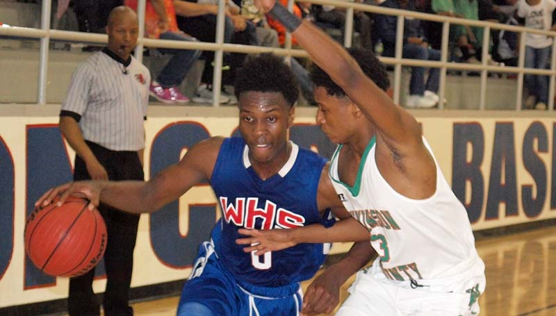 Daily Leader / Tracy Fischer / Wesson's Anthony Jones (0) tries to drive past Wilkinson County's JaQuarious Stewart (3) in boys' action Friday night at Wesson.