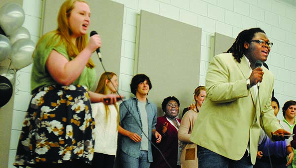 Photos by Aaron Paden / Mississippi School of the Arts junior vocalists perform during the annual Senior Prom hosted by the Jimmy Furlow Senior Center at the FEMA Building Monday.