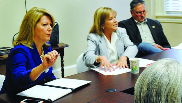 Photo by Aaron Paden / Sen. Sally Doty and Reps. Becky Currie and Vince Mangold discuss education bills with their constituents Monday.