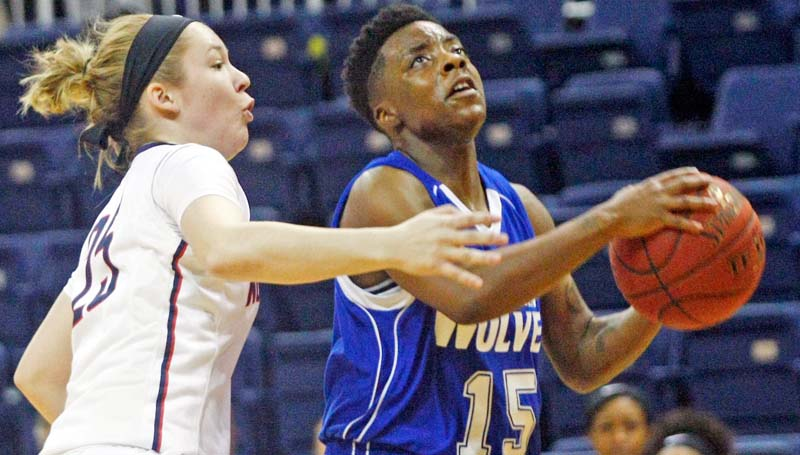 Co-Lin Media / Photo courtesy of JUCOWeekly / Co-Lin point guard Alexis Collins (15) blows past Northwest's Hayley Davis (25) for the layup in the opening round of the MACJC State Tournament at Itawamba.